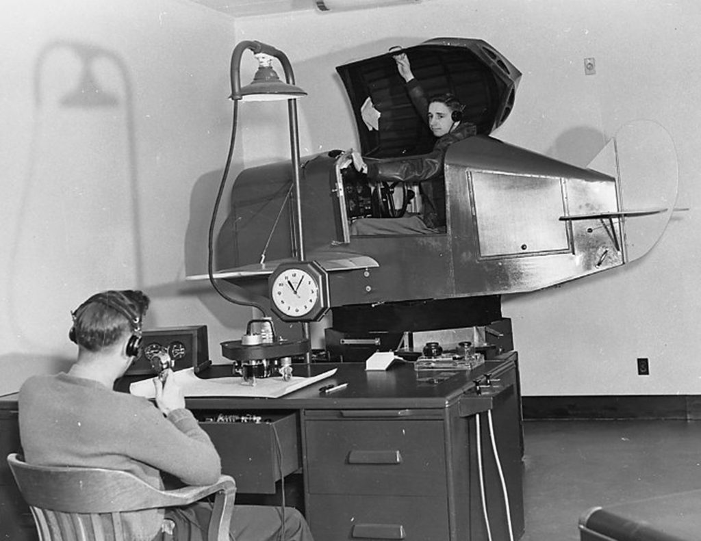 Link Trainer 1930s-to-50s. Developed for safe instrument training. Had force-feedback technology.